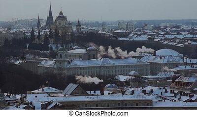 City roof house street winter sunset smoke