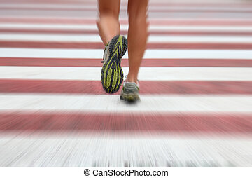 City runner - City Running. Closeup of woman running shoes...