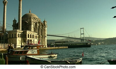 City Scene with bridge boats and mosque in Istanbul