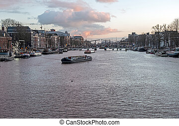 City scenic from Amsterdam at the Amstel in the Netherlands ...