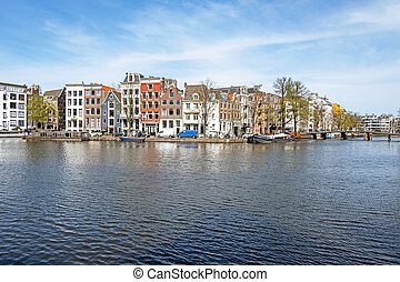 City scenic from Amsterdam at the river Amstel in the ...