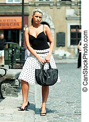 City shopping - Woman with shopping bag