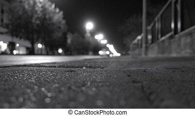 sidewalk illuminated by car headlights - City sidewalk ...