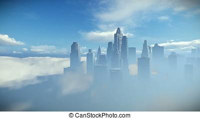 City skyline against blue sky, flight over clouds