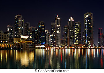 City skyline from Dubai Mall near Burj Khalifa by night, ...