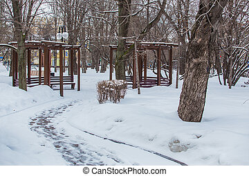 city square with gazebos in the winter