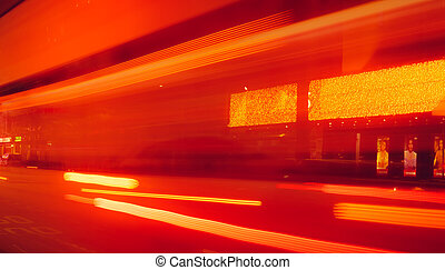 City street in the night with blurred fast speed car light. Red and yellow light at the rod beside the building. Night light abstract background. Blurred motion of light on the road.