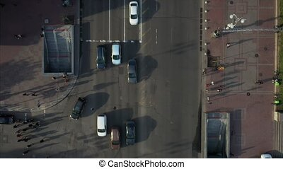 City street, people cross the road, view from above, car traffic