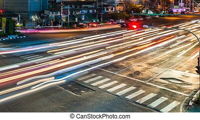 CITY STREET TRAFFIC AT NIGHT