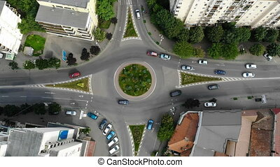 City street traffic from above, roundabout road