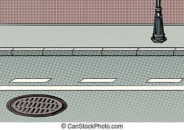 City street with sidewalk and manhole
