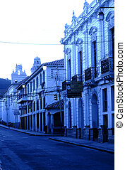 City streets illuminated in the early morning gloom in the colonial town of Sucre- Bolivia
