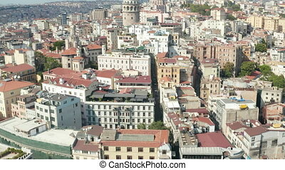 City Streets of Istanbul Tilt up to reveal Galata Tower in Taksim on Sunny Day, Aerial wide establishing shot