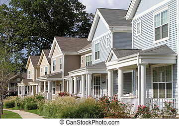 City Townhomes - Row of newly constructed townhomes in a...