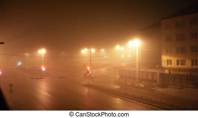 City traffic in a foggy night, time lapse