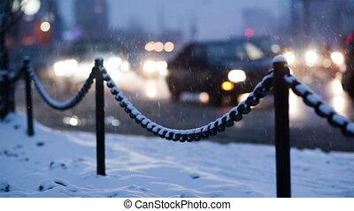 City traffic on a winter evening