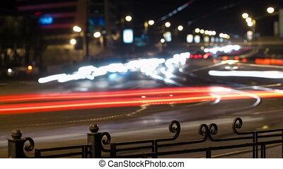 City traffic panning time lapse at night.