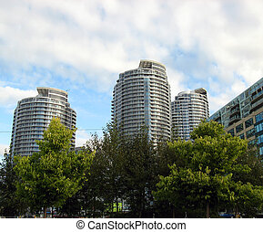 City view - A city view from the park with buildings under...