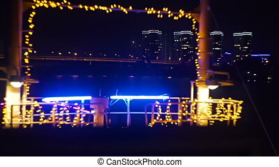 City view from a boat decorated with holiday garlands