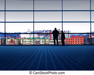 City View - Man and son view the city through large glass...