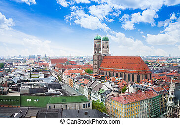 City view with sky, red roofs in Munich