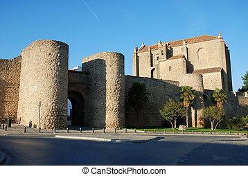 Old city wall with gate in Ronda, Spain