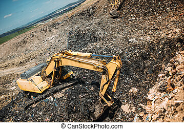 city waste on dumping grounds. Details of industrial excavators working, digging and loading