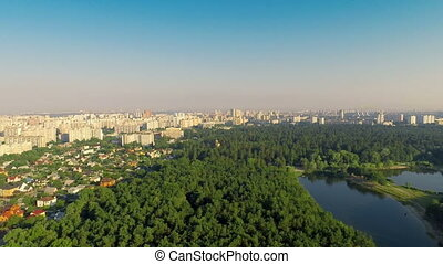 City With a Bird's-eye view in Spring - Aerial shot: City...