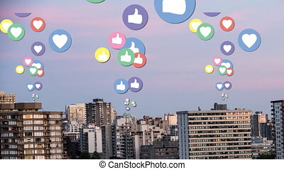 City with tall buildings and flying social media icons