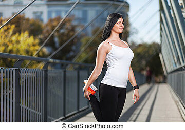 City workout. Beautiful woman training in an urban setting -...