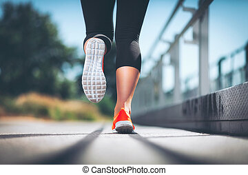 City workout. Woman running in an urban setting - City...