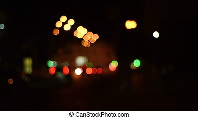 City's colorful night lights blurred background - City's...