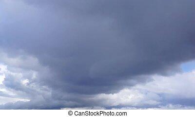 Cityscape and cloudscape tilt down - Cityscape and...