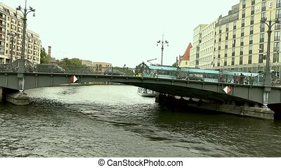 Cityscape and Weidendammer Bridge on Spree river in Berlin city, Weidendammer Brcke, tourist ships on the river Spree, Friedrichstrasse, Berlin, Germany