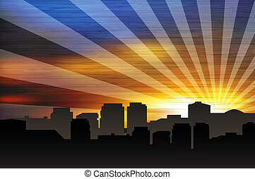 Cityscape at sunset with sunrays