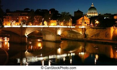 Cityscape bridge over the river, the dome of Saint Peters...