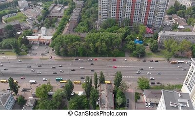 Cityscape car traffic aerial drone view sunny day right truck camera movement