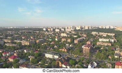 Cityscape drone view aerial long shot big city TV tower houses apartment buildings blue sky sunset Kyiv Ukraine forward movement