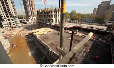 Cityscape from unfinished building, camera moves and show...