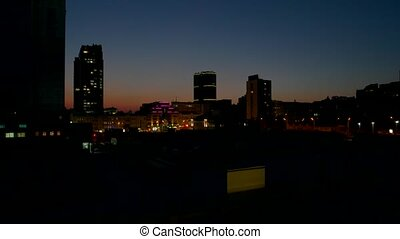 Cityscape in the evening. Light in windows of buildings....