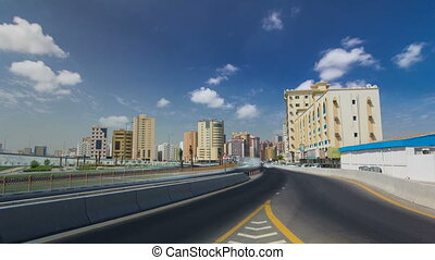 Cityscape of Ajman from bridge at day timelapse. Ajman is the capital of the emirate of Ajman in the United Arab Emirates.