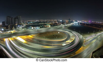 Cityscape of Ajman from rooftop at night timelapse. Ajman is...