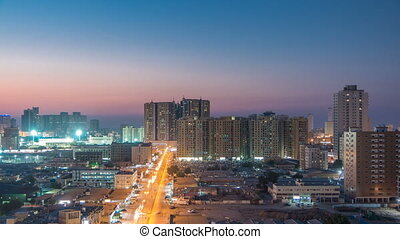 Cityscape of Ajman from rooftop day to night timelapse....