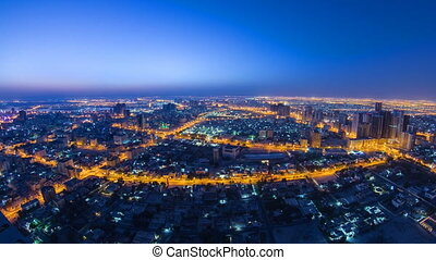Cityscape of Ajman from rooftop night to day timelapse....