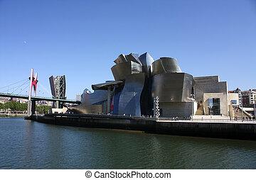 Bilbao Nervion River as it passes by the Guggenheim and bridge La Salve, Euskadi, Spain