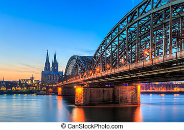 Cityscape of Cologne from the Rhine river with blue sky at...
