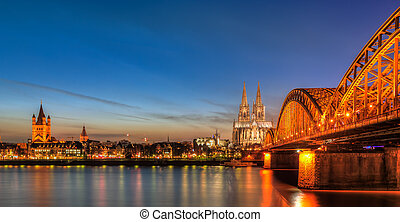 Cityscape of Cologne from the Rhine river at night