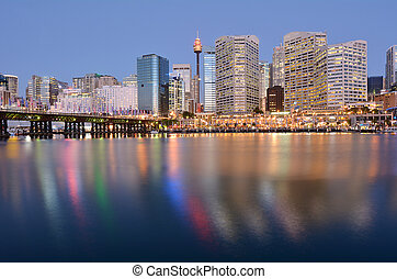 Cityscape of Darling Harbour at dusk, a recreational and pedestrian precinct situated on western outskirts of the Sydney central business district in New South Wales, Australia.