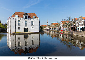 Cityscape of Delft with historic houses and army museum, the Netherlands