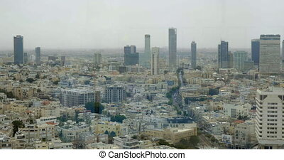 Cityscape of densely populated Tel Aviv, Israel - Panning...